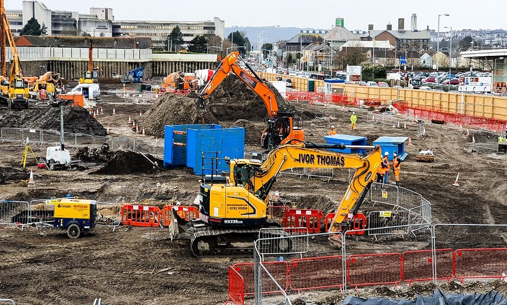 A groundwork construction site that has a manhole box and groundworks support equipment