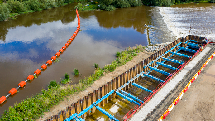 Four sided ground support excavation next to a fish pass or river