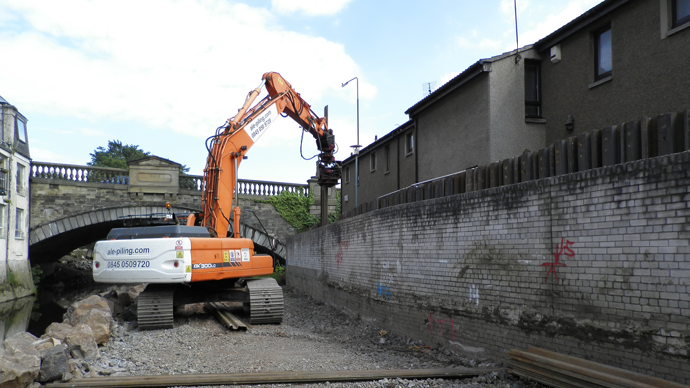 Trench sheets or sheet piles being driven into the groundwork