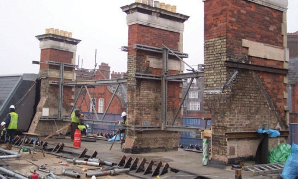 Mass 25 supporting chimney structures on a commercial building